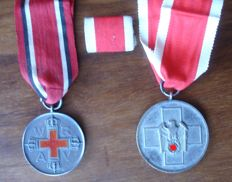 Collection of 2 orders / medals / and rock clip/ Red Cross, and people care / WW 2