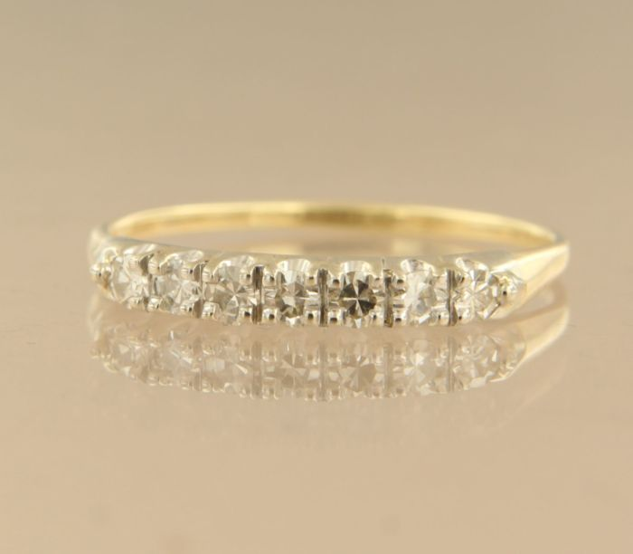 14 kt white gold ring with 7 octagon cut diamonds set in