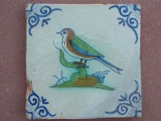 Antique polychrome tile depicting a bird (rare)