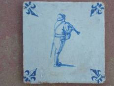 Antique tile depicting a musician. Rare!