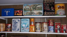 Large collection of cans and tins