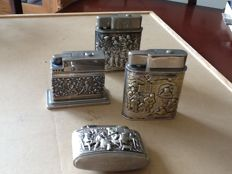4 silverplated gas lighters.