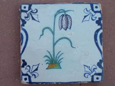 Antique baluster type tile with polychrome flower, with lilies, rare