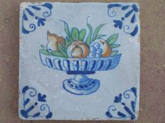 Antique tile with a polychrome fruit bowl. Special scene!