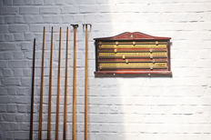 Set of 7 snooker cues and a score counter in mahogany brand ECB