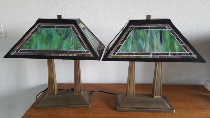 A pair of desk lamps with glass lampshades