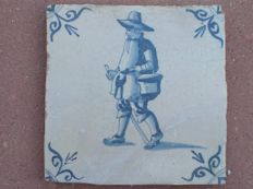 Antique tile with figure, special depiction