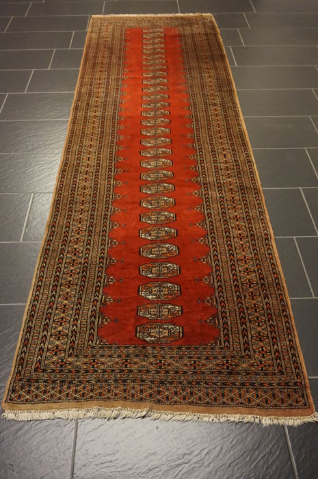 Magnificent hand-knotted Oriental carpet Buchara Jomut Kazak pattern, runner 95 x 320 cm. Made in Pakistan, mid of the 20th century