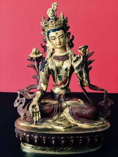 Depiction of the White Tara in copper with a brown and gold patina, Nepal, early 21st