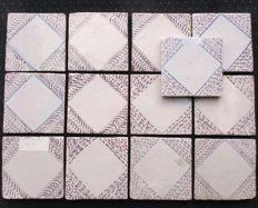 13 Square tiles with speckled manganese surface