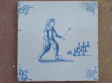 antique tile with children's play