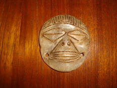 Taino Greater Antilles - Zemi - anthropomorphic pendant - carved, chiselled and polished light coloured stone - height: 0.3 mm, length: 58 mm, width: 52 mm.