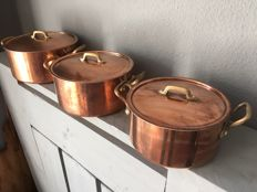 Three copper pans with lid