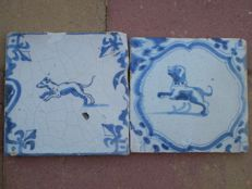 Lot with 2 antique tiles with animals.