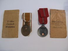 Schutzwall and Ost Medal with Ribbon and issue pouch.