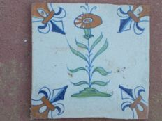 Antique tile with multicoloured flower. Rare type.
