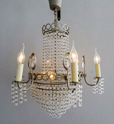 Chandelier of silver-grey metal with many crystal chains