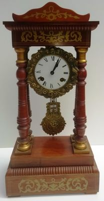 Walnut column pendulum clock with marquetry inlays and bronze ornaments - 1960s