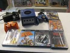 Nintendo Gamecube including  2controllers and 6 games like : Super smash bros, Resident evil 4, Call of duty 2 and more