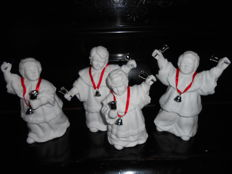 Caroling Bells, three figurines in white porcelain