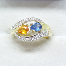 Gorgeous Natural top grade 0.71cts Thai Orange Sapphire, Cornflower Blue and White Sapphire in yellow gold. Stunning Design
