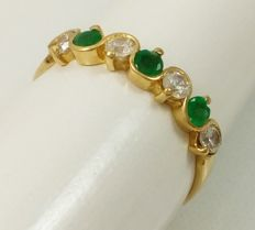 18 kt/750 yellow gold with emeralds and zircons. Number: 16/56