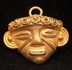 Tumbaga Gold , artifact , Colombian ,  Tairona Culture  , 24 x 28 x 4 mm , 5,4 grams , A pendant of an indian warrior mask