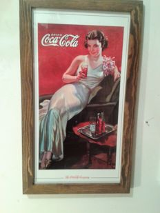 Coca Cola retro. Picture in a wooden frame. Coca Cola advertise from USA. ca. 1990/95.