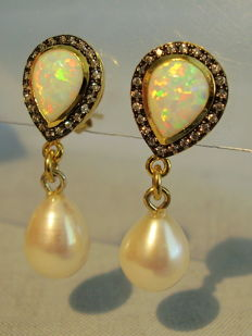 Stud earrings with opal droplets and white topaz entourage as well as genuine white cultured pearls