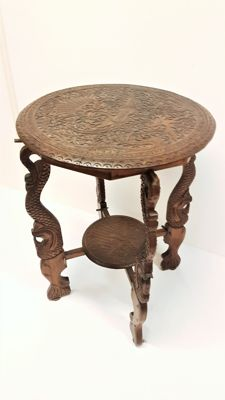 Wood carving, side table with images of peacocks, second half 20th century, Netherlands