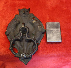 Neo-Gothic bronze door knocker with the mouth of a demon to gargoyle