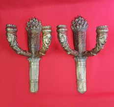 Heavy brass sconces featuring angels