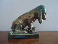 Cytère Rambervilliers pottery, Unis France - Dog made of blue-green enamelled stoneware