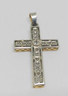 Yellow and white gold cross with white sapphires, from the late 19th century.