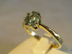 14 kt gold ring with faceted, verified blue topaz of 1 ct.