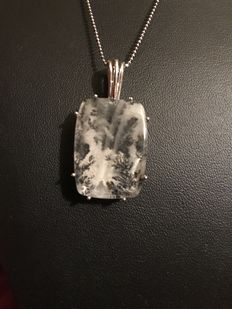 Silver pendant with fossil quartz, does not include necklace.
