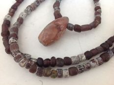 Ancient islamic excavation glass beads with neolithic pendant, ca 62 cm