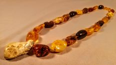 Genuine vintage mix colours Baltic Amber necklace, length ca. 61 cm, 84 grams