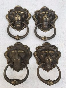 Four brass lion heads with handle - France - ca. 1900