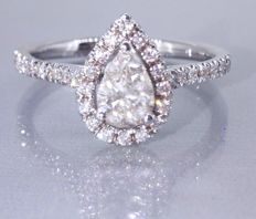 Diamond ring with pear cut diamond, IGI certificate for 0.60 ct, and 32 diamonds of 0.30 ct