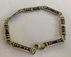 Gold bracelet with blue and red beads