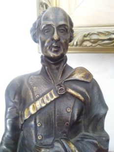 Bronze sculpture depicting a French character