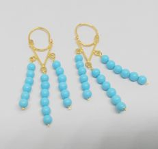 Earrings in 18 kt yellow gold with turquoise beads