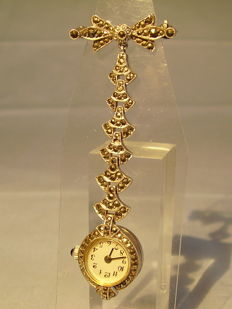 Antique brooch with bow and hanging watch with marcasite setting, around 1940