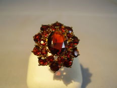 Large gold ring with garnet - setting on three levels