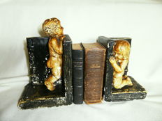 Antique bookends with angels - signed H. Lingero and numbered - two matching decorative books on votives