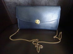 Pourchet – Clutch bag with golden chain.