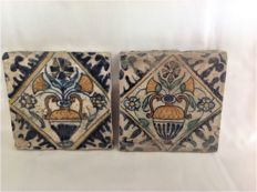 Two unrestored early 17th century colour flower tiles.
