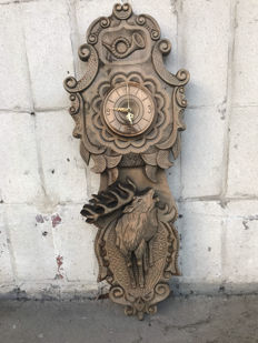 Polish clock, richly carved