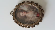 Antique pendant with hand-painted cameo